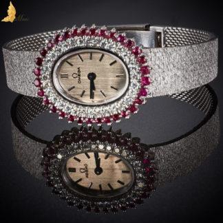 Damska Omega brylanty, rubiny w białym złocie 18K