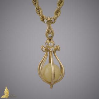Zawieszka 'Celebration' z brylantami 0,55 ct i bursztynem Royal Amber w 18K żółtym złocie