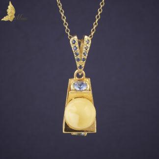 Zawieszka projektu J.Barona z serii Reverie z bursztynem i szafirami w 18K złocie