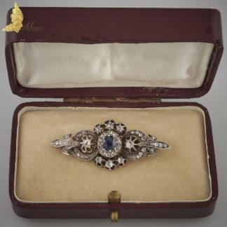 Brosza z rozetami diamentowymi i szafirem w 14K złocie, XIX / XX w.