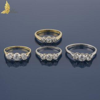 Antyczne pierścionki z trzema brylantami w platynie i w złocie 18K